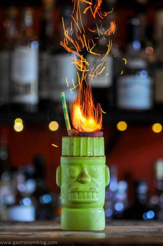 Green tiki mug with flaming peach