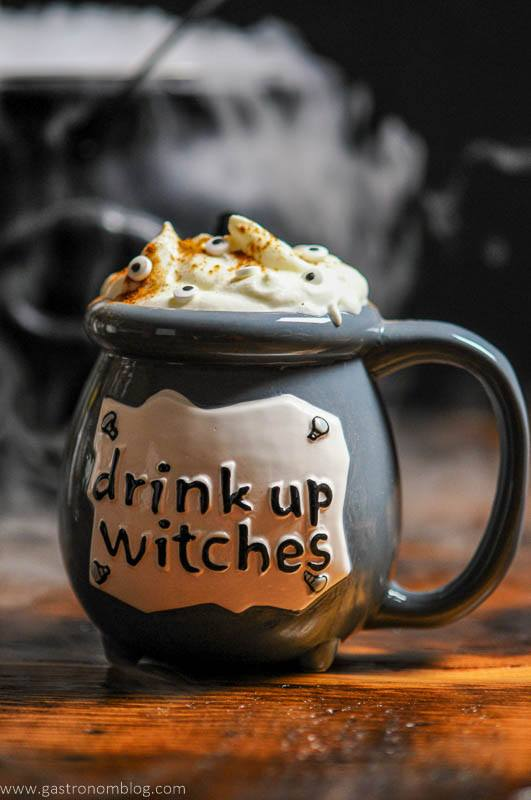 Gray Cauldron holding a Halloween Cocktail