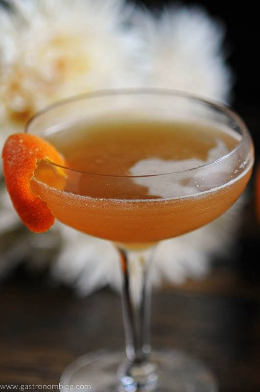 cocktail in coupe with orange peel garnish