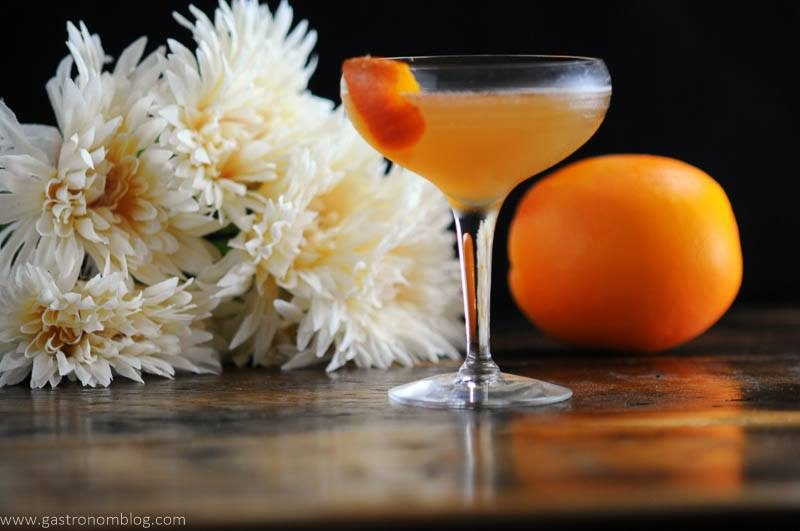orange cocktail in coupe