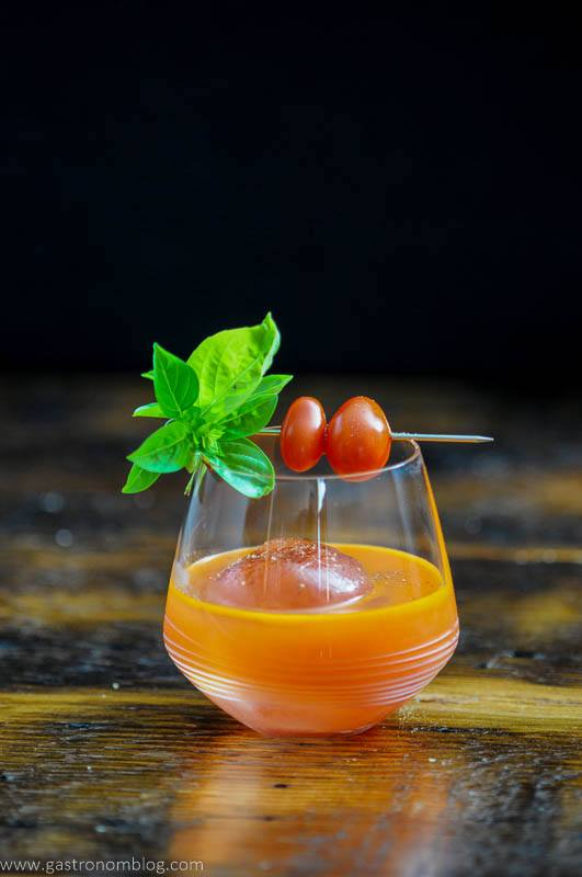 Orange cocktail with tomatoes and basil