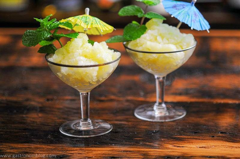 Yellow frozen dessert with pineapple and mint