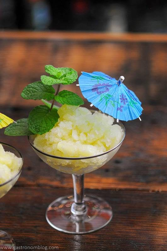 Uellow granita in cups with umbrella