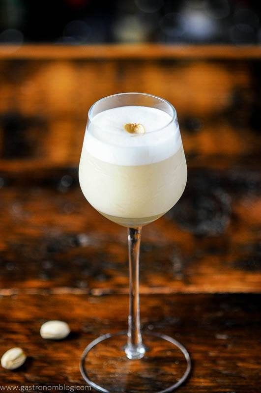 Creamy cocktail in tall glass