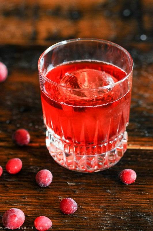 Top shot of red cocktail and cranberries
