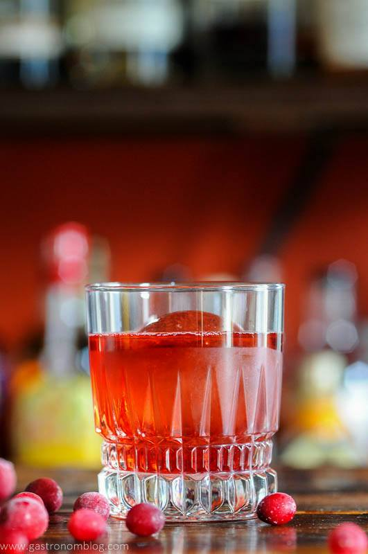 Red cocktail with cranberries
