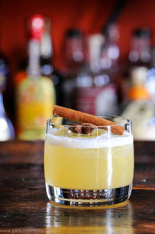 Spiced Gin Punch in rocks glass, spices as garnish