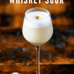 creamy colored cocktail in tall glass