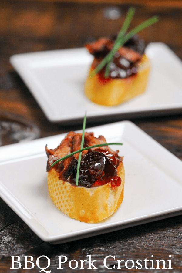 Pork Crostini appetizers on white plates