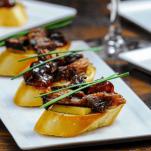 Pork Crostini on white plates