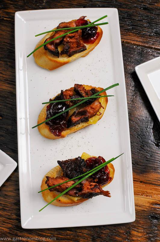 3 Pork Crostini on white plate
