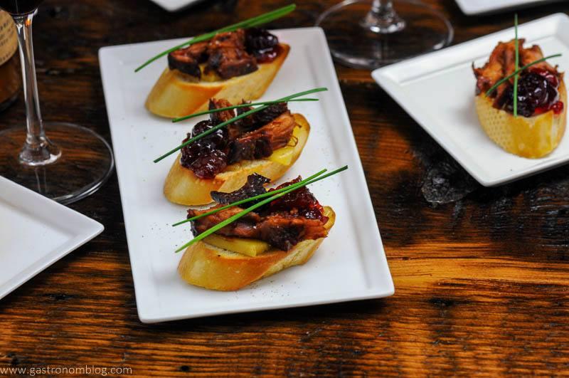Pork Crostinis on white plates