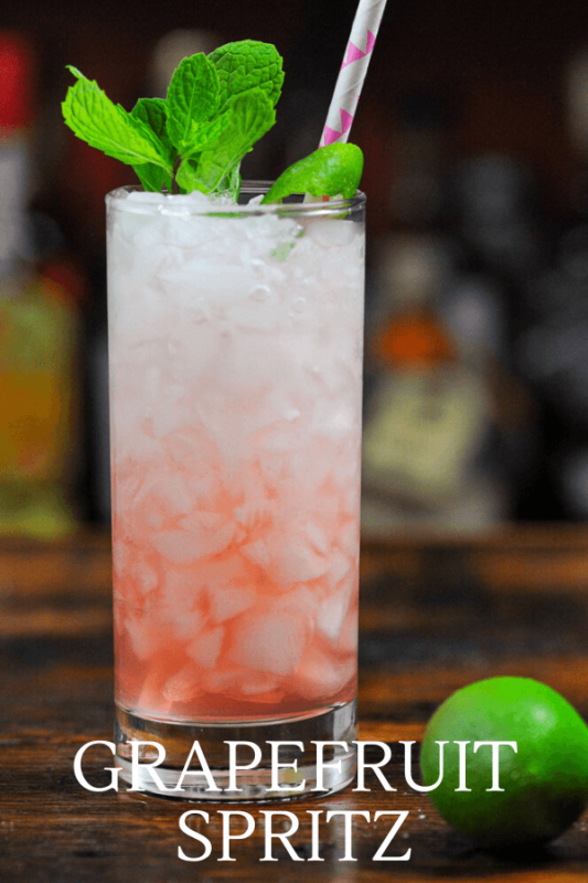 Pink drink in tall glass with mint