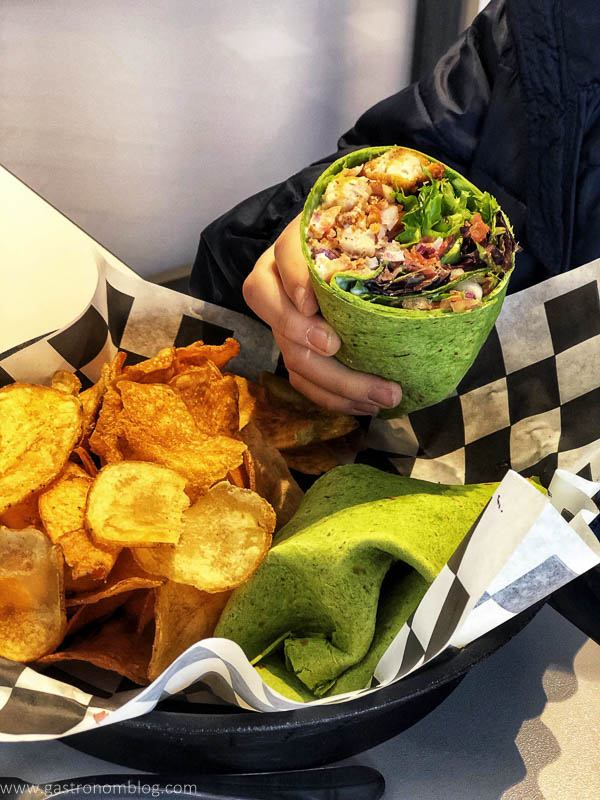 Wrap sandwich and chips in a basket