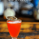 Strawberry cocktail with citrus slice garnish
