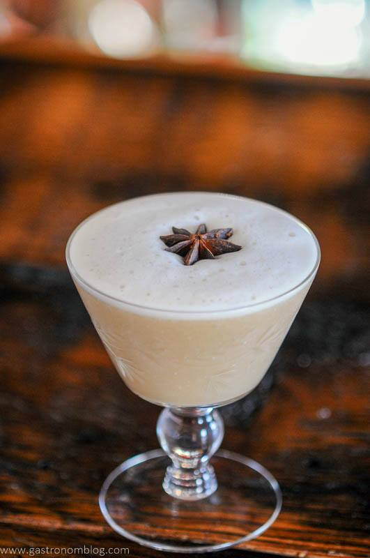 tan Cocktail with star anise on foam