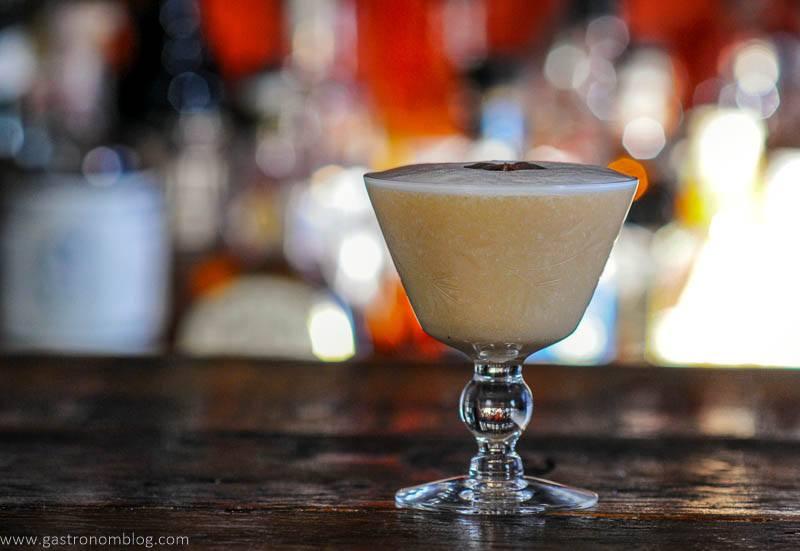 tan Cocktail in glass, white foam