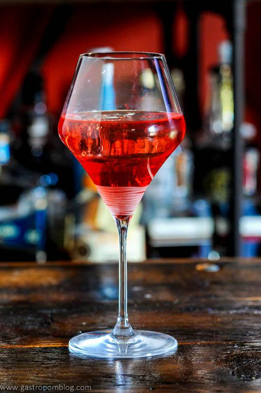 Pink cocktail in wine glass