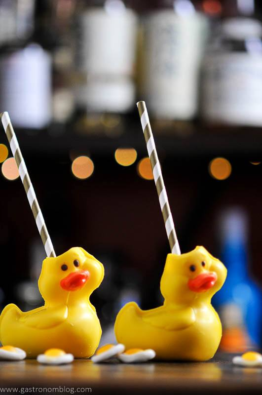Cocktail in chocolate duck vessels with straws