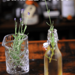 Syrup in bottle, lavender sprigs in mixing glass