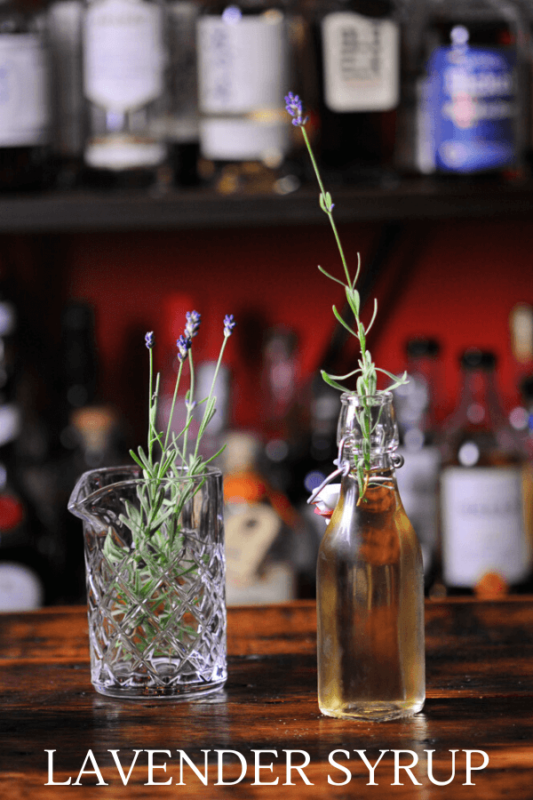 Syrup in swingtop bottle, lavender sprigs in mixing glass