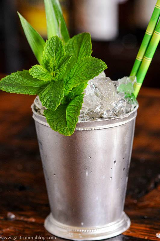 Silver cup with crushed ice and pineapple fronts and mint