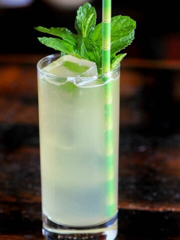 Hatozaki Whiskey in a Highball glass wtih mint and green straw