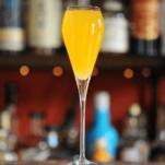 Peach Belllini in tall glass