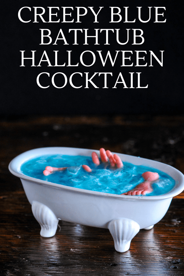 Blue cocktail in white bathtub cocktail glass, body parts in cocktail