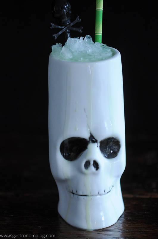 Key Lime Colada cocktail in a skull tiki mug