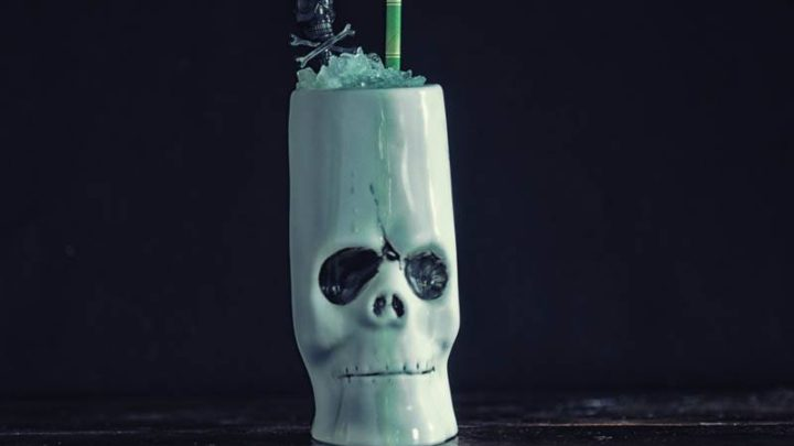 Key Lime Colada cocktail in a skull tiki mug