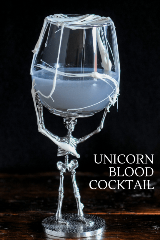 Purple cocktail in skeleton glass, marshmallow strands over glass