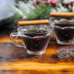 Purple Punch in cups with cinnamon sticks
