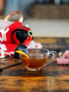 Hot Gin Toddy in tea cup with orange zest