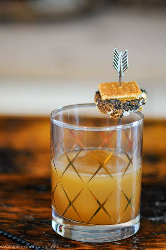 S'mores cocktail in gold etched glass, small s'more on garnish pick