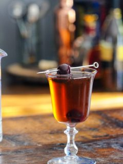 Chocolate Manhattan in a coupe, cherry on pick