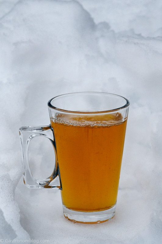 Cocktail in glass mug with handle in the snow