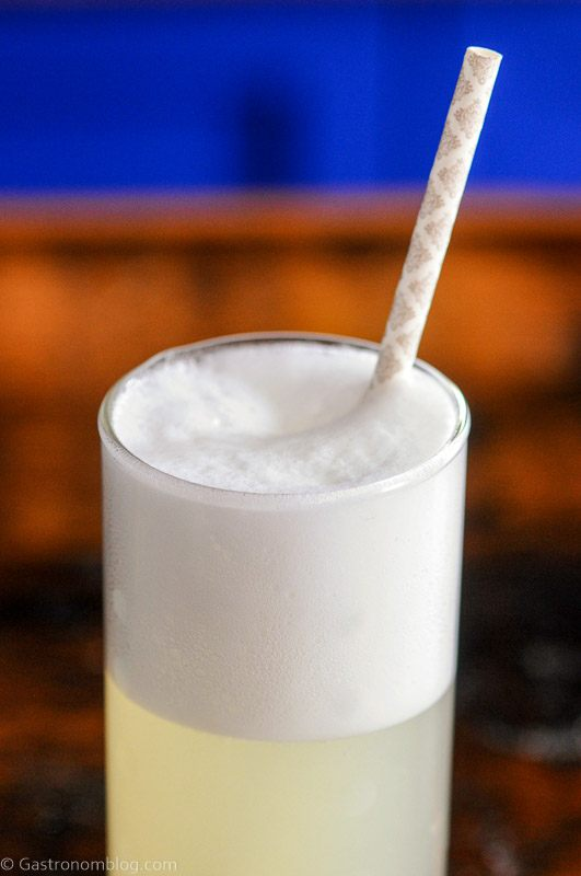 Gin Fizz cocktail recipe in a tall glass with a straw