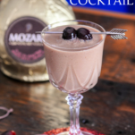 chocolate cocktail in coupe with liqueur bottle behind