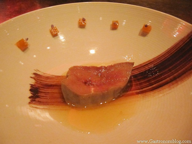 meat in a bowl, garnished with dark sauce at e by Jose Andres