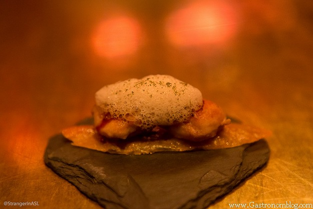 Chicken skin with foam on top at e by Jose Andres