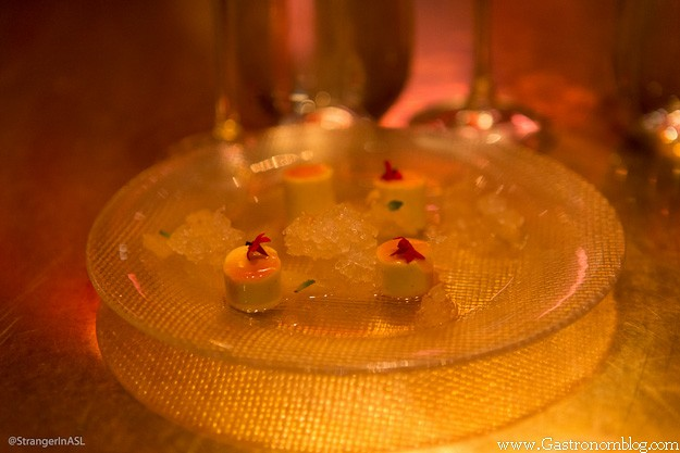 tiny flans on glass plate at e by Jose Andres