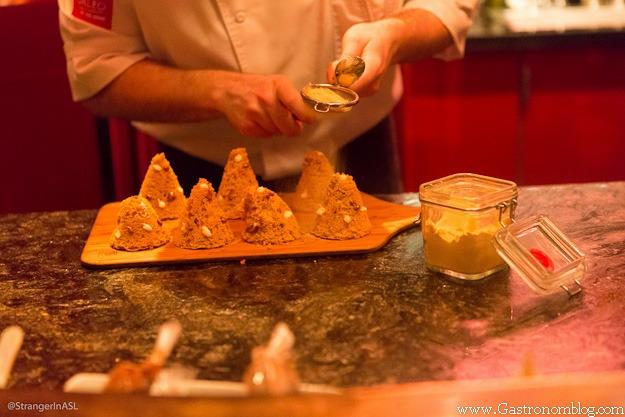 chef garnishing lemon cakes