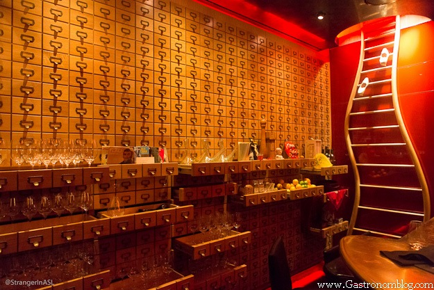 Inside of e by Jose Andres - gold wall with drawers, shelves wtih ingredients