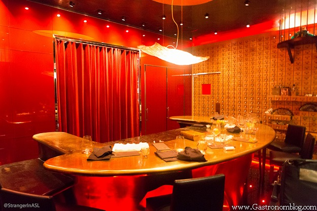 Inside of e by Jose Andres, golds and red curtains everywhere