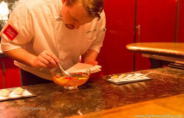 Chef using tweezers to plate
