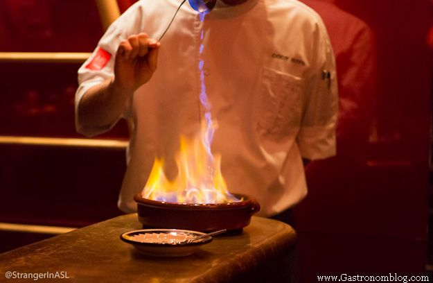 Chef making fire for a dessert