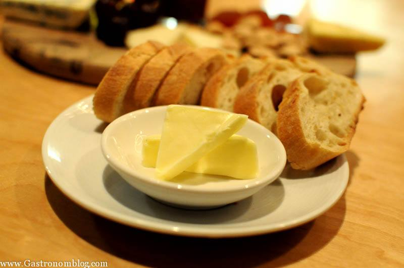 Bread plate with butter in ramekin