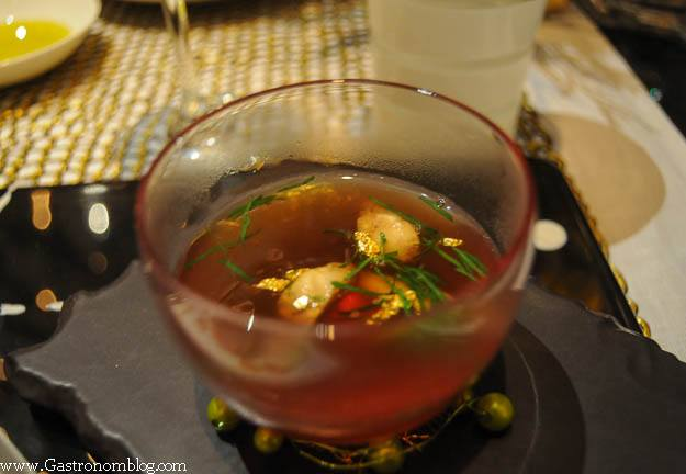Mushroom broth in a glass bowl at Robuchon Las Vegas