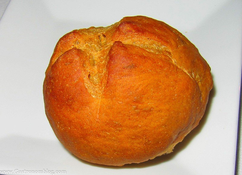 Bread roll on white plate